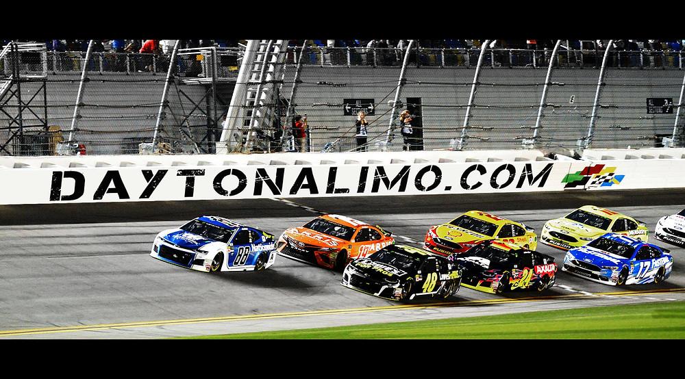 Daytona 500 cars racing and DaytonaLimo Sponsor logo in the background