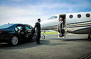Orlando Limo chauffeur opening door for passenger for Orlando Airport Transpotation