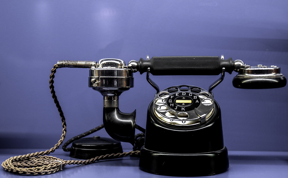 old school telephone to invoke vivid imagery on chasing late payments in the old days