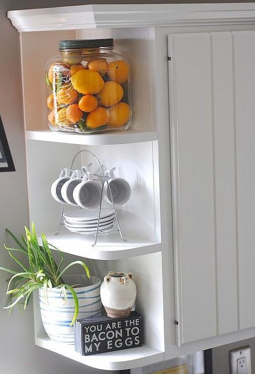 open shelves to the end of wall cabinets in your Modular Kitchen