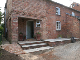 Brazilian sandstone step to replace old concrete slope and added side sloped access, bricket finish and English Bond