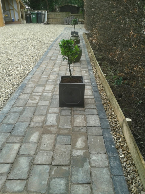 Tegqula paving laid Engligh bond style with a timber boarder edging