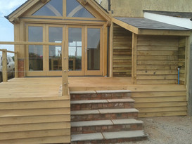 Decking, log store and steps