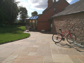 Indian sandstone paving with belfast sink for boot washing