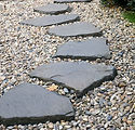 Path of plated stones on gravel bed in J