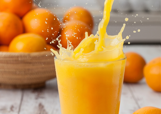 Orange juice pouring splash.png
