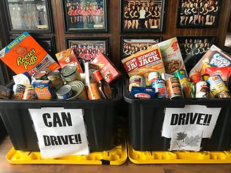 Food Drive Image. Two bins full of canned and non-perishable goods.