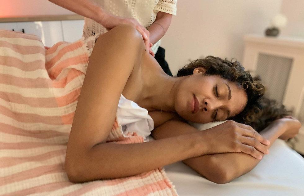 Woman receiving a relaxing massage at Metta Massage and Wellness.