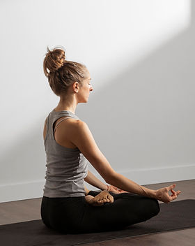 adult-woman-meditating-at-home.jpg