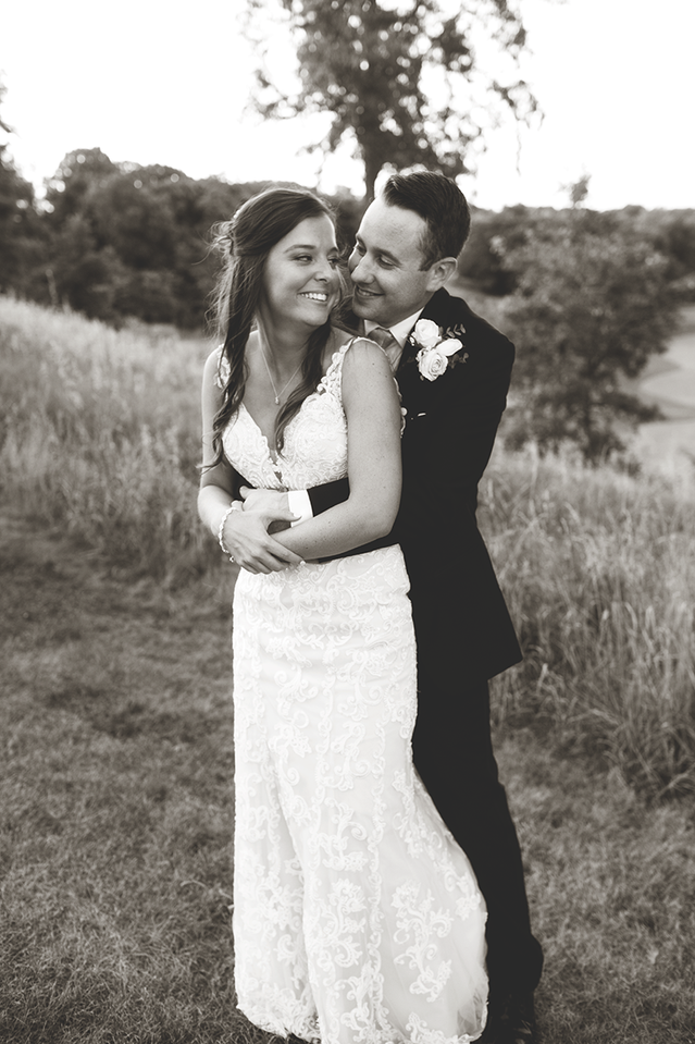 Summer Wedding of Bride and Groom snuggling at Weaver Ridge Golf Course Peoria, Illinois