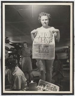 fp4512(WomanBarracks_NewspaperJapanSurrenders)