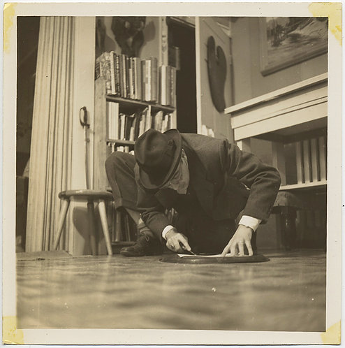 LOW ANGLE FLOOR SHOT UNUSUAL MAN in FEDORA PRIES  DISK LOOSE WEIRD