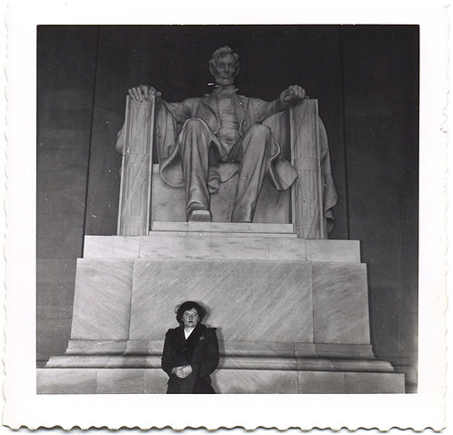 DOUR UNHAPPY WOMAN DWARFED by STERN LOOKING LOOMING LINCOLN at LINCOLN MEMORIAL