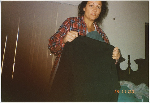 UNUSUAL!  HAUNTED FEARFUL WOMAN being DEFENSIVE with GARMENT