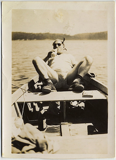 MAN with MAJOR CROTCH SHOT BULGE RELAXES on ROWBOAT with BOOZE