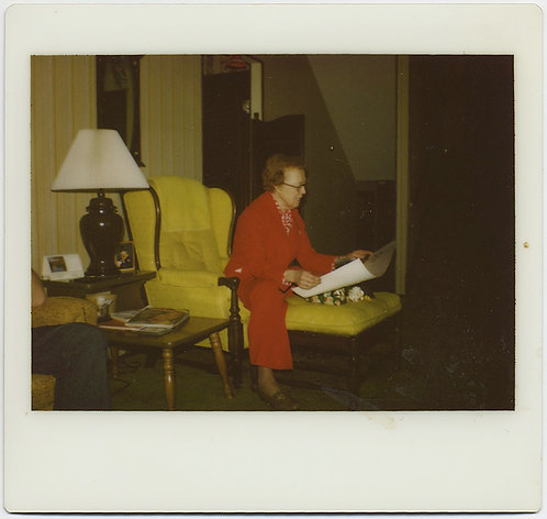 POLAROID KODAK INSTANT WOMAN in RED READS on FUNKY YELLOW CHAIR OTTOMAN!