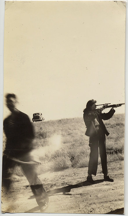 SUPERB! WOMAN FIRES RIFLE w SIGHTS MOVING MAN ACTION BLUR & VINTAGE CAR on HILL!