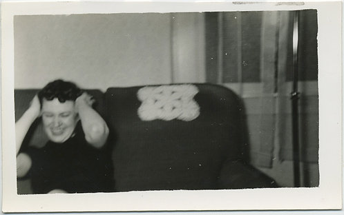 HEAR NO EVIL! Blurry woman blocks ears on couch!