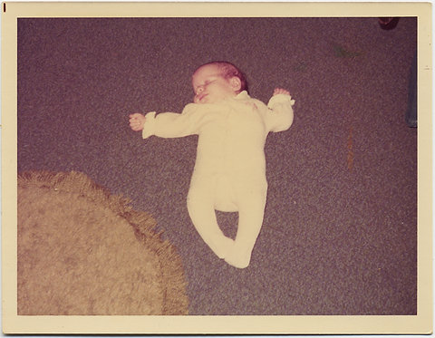 EERIE FLYING BABY in ALMOST CHRIST LIKE CRUCIFIXTION POSE on CARPET