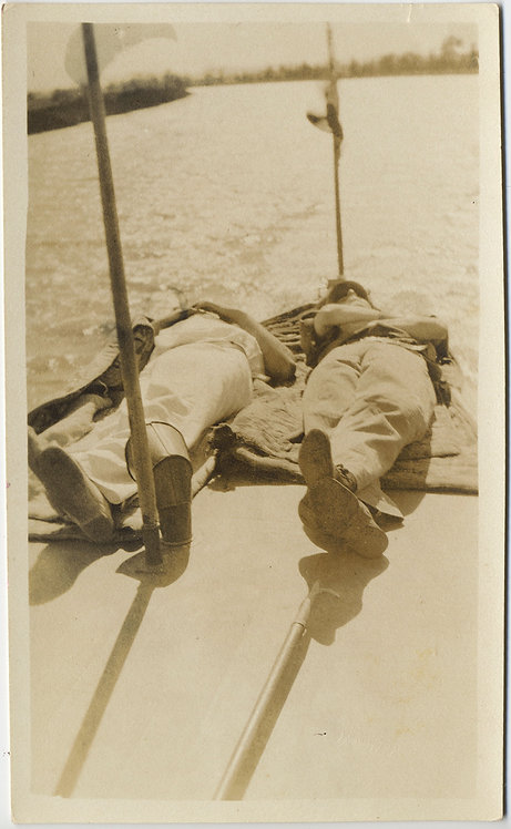 LAZY DAYS LOITERING LOLLING MEN LIE on BOAT DECK DREAMING