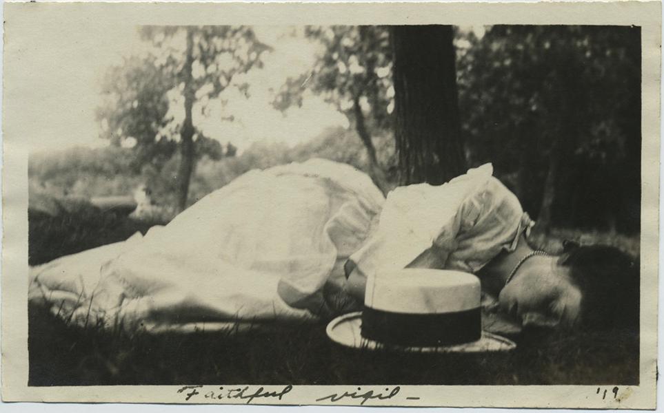 fp8442(Woman-Sleeping-Grass-Caption)