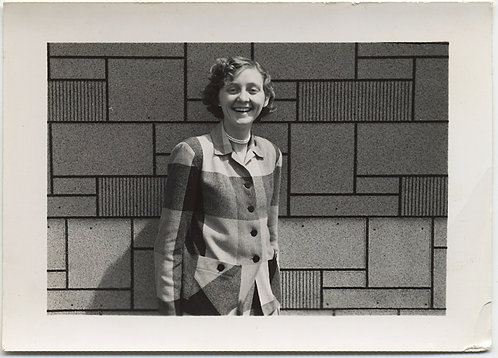 SMILING WOMAN in MONDRIAN INSPIRED SWEATER MEETS MONDRIAN INSPIRED WALL UNCANNY!