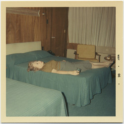 fp8743(Woman-Motel-Room-Bed)
