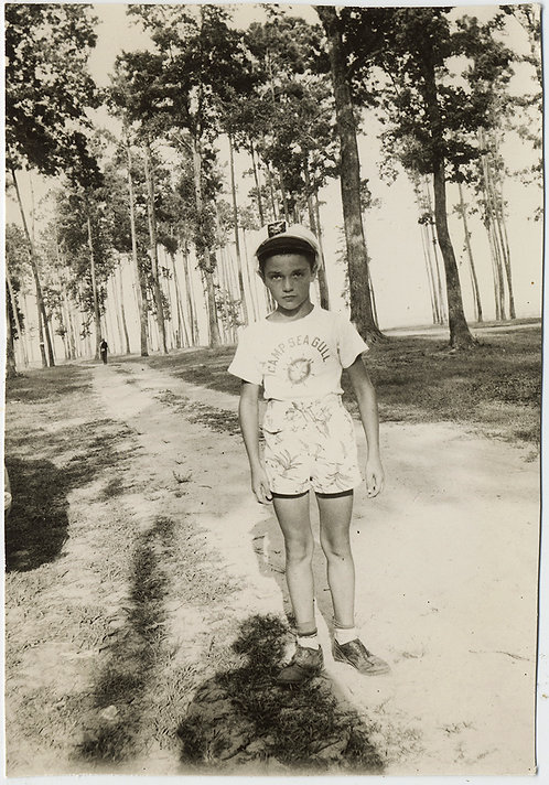 SERIOUS LITTL BOY in CAPTAINS SAILORS CAP  w SHADOW in GROVE of TREES