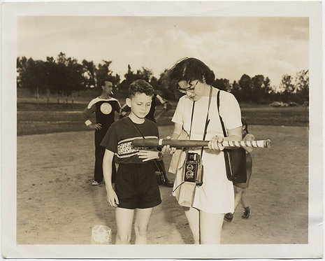 UNUSUAL WOMAN w TWIN LENS REFLEX CAMERA EXAMINES YOUNG BOY'S BASEBALL BAT