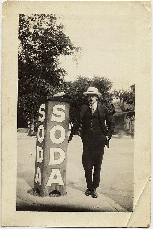 SUPERB! DEBONAIR STYLISH MAN LEANS on AWESOME SODA AD PILLAR