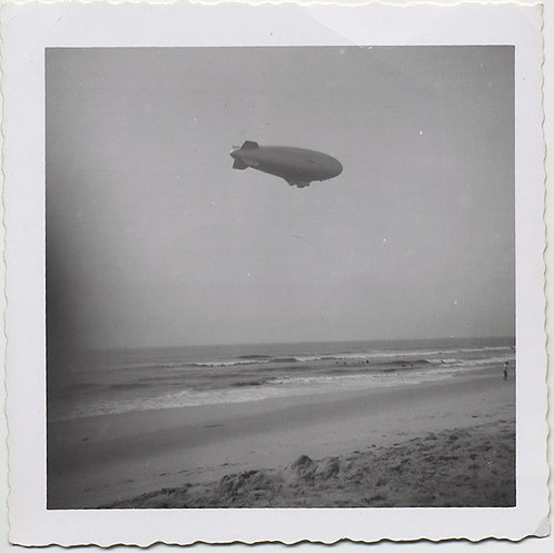 LOVELY BLIMP AIRSHIP ZEPPELIN DIRIGIBLE HOVERS above BEACH
