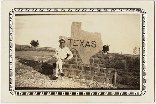 DASHING DEBONAIR HANDSOME MAN POSES at TEXAS STATE LINE MARKER SIGN WELCOME