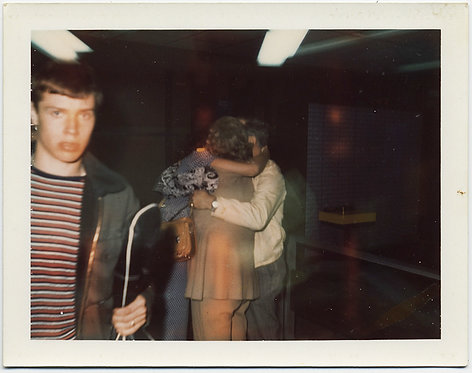 DISTURBED YOUNG MAN WALKS AWAY from EMBRACING GROUP in EERIE POLAROID