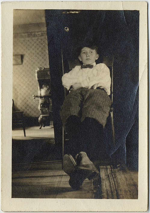 YOUNG BOY STRETCHES OUT RELAXES at KITCHEN ENTRANCE WOOD STOVE BOW TIE KETTLE