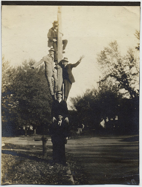 MEN UP a POLE YOUNG STUDENTS UP to TALL HIJINKS on UTILITY POLE