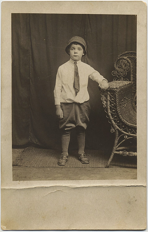 ADORABLE CUTE CHARLIE in BIG BOY SUIT WICKER CHAIR STUDIO PORTRAIT CAPTION RPPC