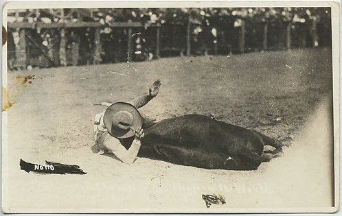 RPPC RODEO BULL WRANGLER (McDonnel?) on GROUND World Champion Bulldogger CAPTION