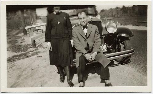 MAN SITS on VINTAGE CAR FENDER w BAD CROP EYELESS WOMAN WEARING CRUCIFIX