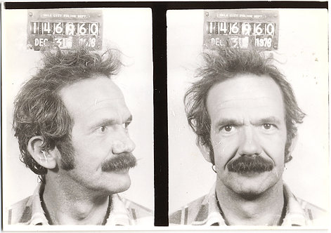 MUSTACHIOED DISHEVELED WINDBLOWN CON-MAN w NUMEROUS ALIASES MUGSHOT