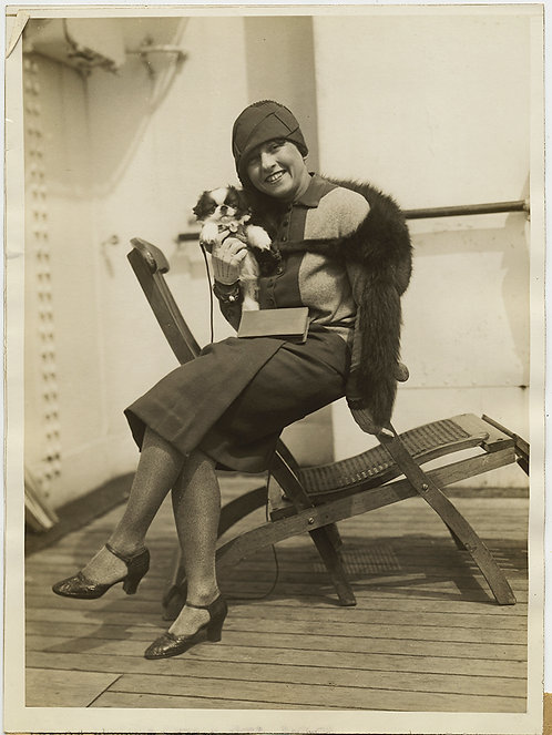PRESS PHOTO TOOTHY GAL w CUTEST PUPPY DOG EVER in MONTE CARLO SPORT HOSE ARRIVES