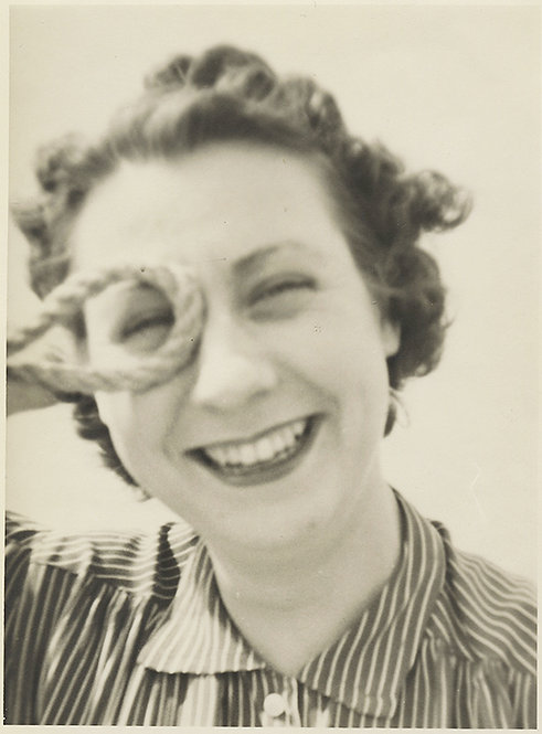 LAUGHING PLAYFUL WOMAN FRAMES EYE with COIL of ROPE!
