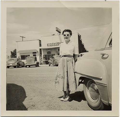 50's WOMAN w. GREAT SUNGLASSES stands near MOSES!