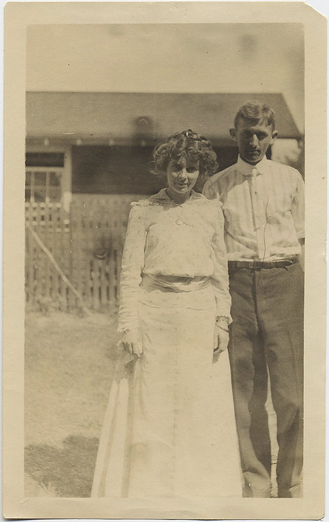 STUNNING SIMPLE PORTRAIT of COUPLE in front of HOME YOUNG AMERICAN GOTHIC