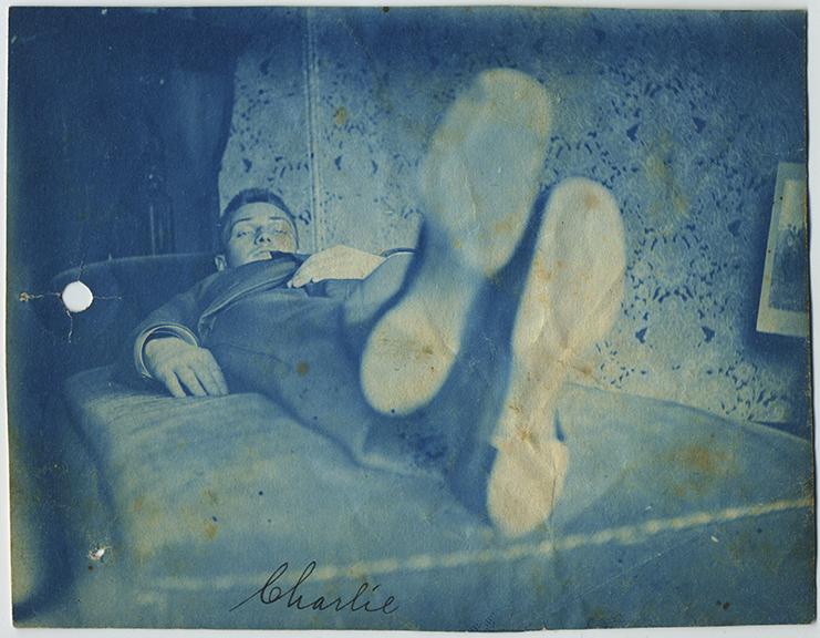 fp6704(CY_ManLyingDown_Feet_CaptionCharlie)
