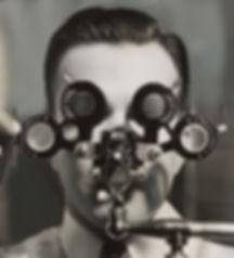 man looking through optometrist's measuring tool