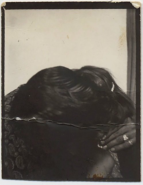 KISSING COUPLE in PHOTOBOOTH EMBRACE in CLINCH FACES OBSCURED