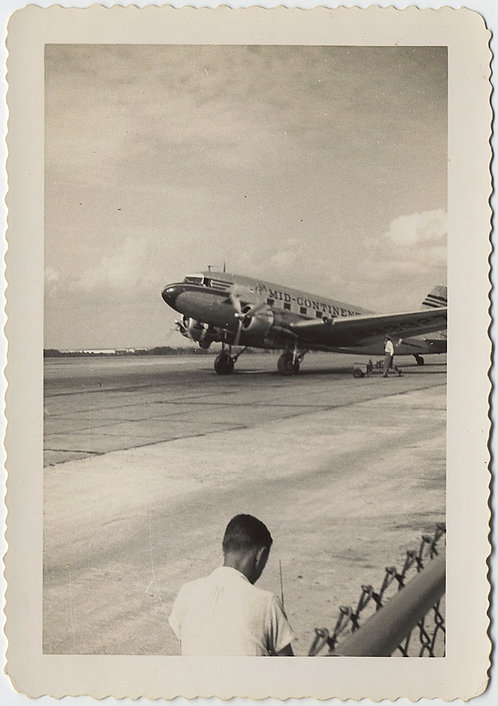 BACK of MAN's HEAD CHAIN LINK FENCE & MID-CONTINENTAL AIRLINES DC 3 PLANE Tulsa