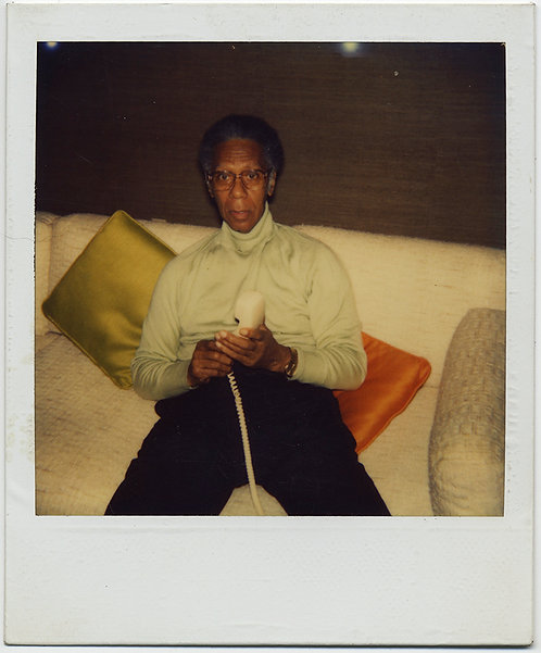 FASHIONISTA BLACK MAN on MID CENTURY COUCH DIALS WHITE PHONE POLAROID