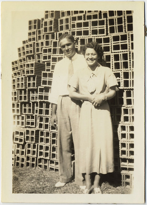 DAPPER COUPLE with BACKGROUND of STACKED BRICKS! UNUSUAL!