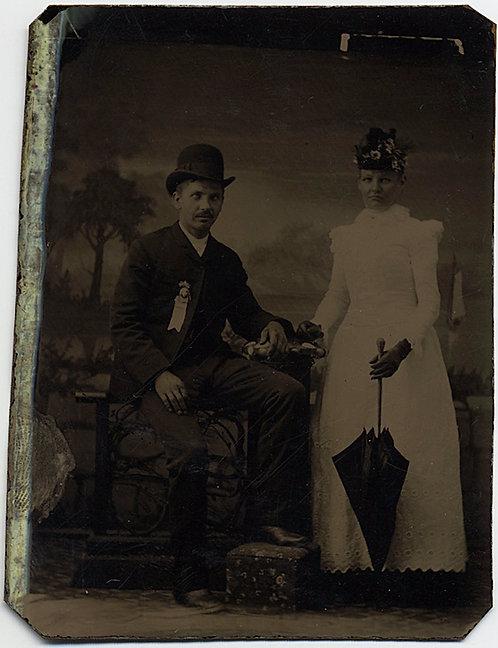 MAN WEARING RIBBON WOMAN w UMBRELLA in STUDIO PAINTED BACKDROP TINTYPE